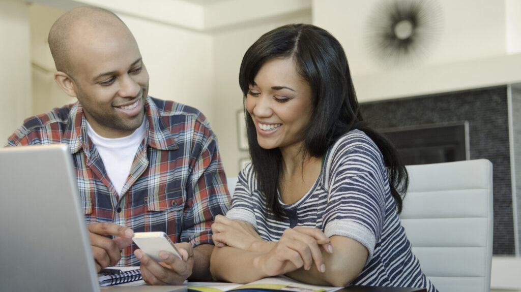 couple deciding if they can afford to sell their home