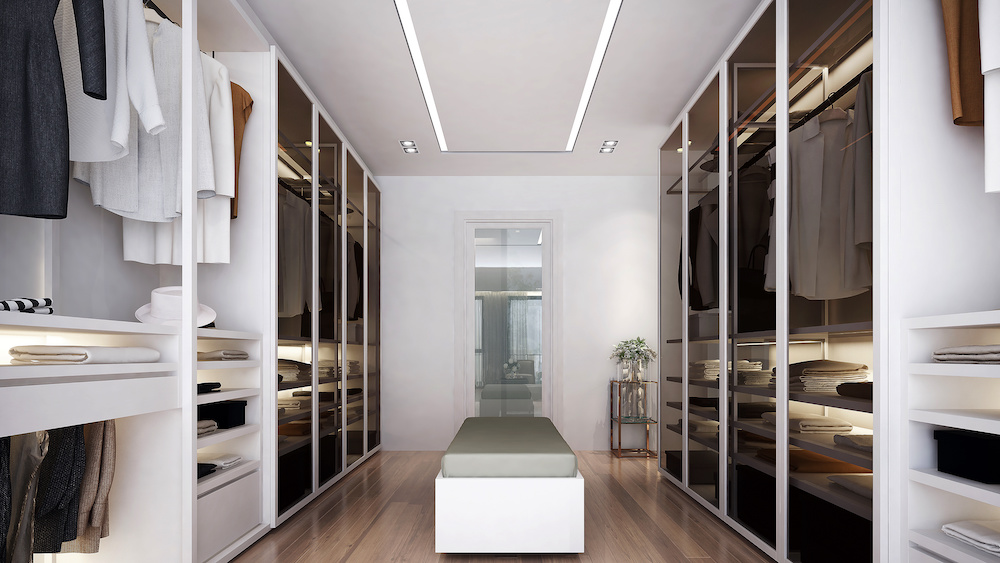 Modern style walk in closet room with white island. Minimalist closet room design, and empty wall background, 3D illustration