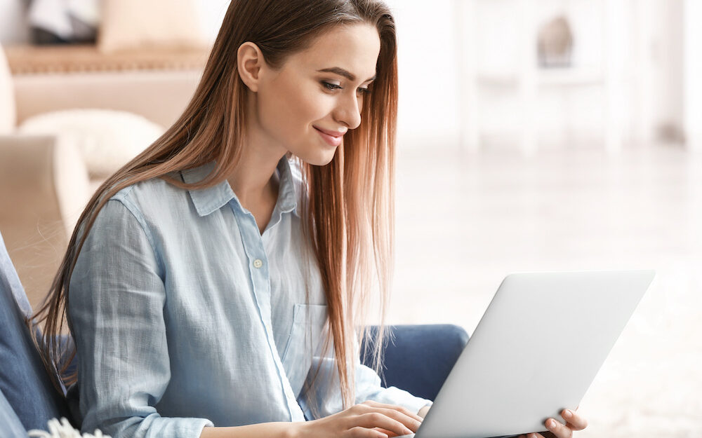 Young woman online at home
